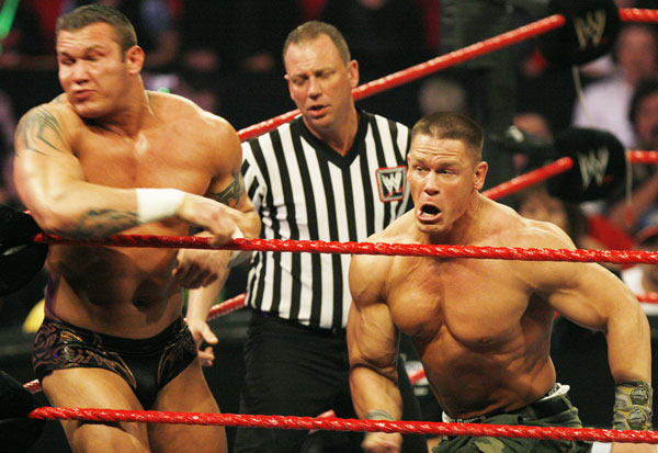 WWE Raw superstar Randy Orton, left, takes a hard hit from John Cena at the