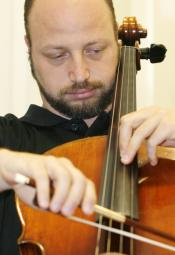Thomas Loewenheim, Ph.D., takes time out to play his favorite instrument, the cello.