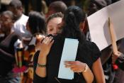 """Cherella Nicholson, left, shares a moment with Zinzi Evans at the Jena Six rally on Thursday. Nicholson, the treasurer of Black Students United, coordinated the rally. """"People need to know; they need to be educated of this situation,"""" Nicholson said."""