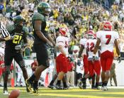 Oregon tight end Ed Dickson celebrates in the end zone after catching a touchdown pass in the second quarter of Oregon