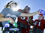 Krista Bayers provides Fresno State football players with proper hydration during Tuesday afternoon