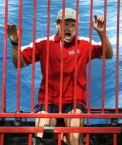 L.J. Fine, professor in the Recreation Administration and Leisure Studies, prepares to take a dive at the professor dunking event. Student participants paid one dollar for a chance to take their best shot at the platforms supporting the four professors who volunteered to get wet. Proceeds will benefit Alcoholics Anonymous.