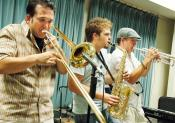 'We're a rock, funk-with-jazz-influence band,' DJ Clovis (far left, trombone) said about Head Rush's Influences. Here, Clovis is playing with fellow member Brian Nunes (center, saxaphone) and Jeff LaRose (right, trumpet).