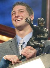 Florida Quarterback Tim Tebow holds up the Heisman trophy after winning the award Saturday night at the Nokia Theater in New York City.  Tebow amassed 462 first-place votes and 1,957 total points.  Arkansas running back Darren McFadden was the runner-up for the award.