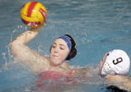 Sophomore Kellie Ellis looks for teammates to pass to during practice at Clovis West High School. The club water polo team has begun practicing twice a week for its season, which begins on Feb. 23 at a tournament where they will face UC Davis and CSU Maritime Academy.