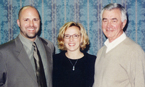 Pictured left to right: current coach Chris Preble, his wife Dana Preble and coach Glenn Carlson.