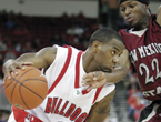Senior point guard Kevin Bell drives to the basket against New Mexico State's Jonathan Gibson during saturday night's conference game against the Aggies at the Save Mart Center.