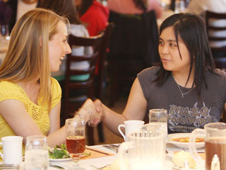 Junior liberal studies major Ellyce Parento (left) and senior electrical engineering major Joanna Samana (right) learned how to properly shake hands in a professional dining situation.