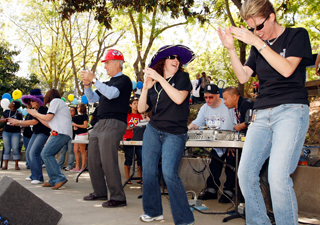 """Dean of Student Affairs Paul Oliaro (left) and the Vintage Days staff performed the """"YMCA"""" dance during opening ceremonies yesterday in The Pit. Booths open up today from 10 a.m. to 5 p.m."""