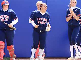Fresno State softball players celebrate a run coming across the plate during its lone victory against Nevada this weekend, 4-1. The Bulldogs dropped the series 1-2 and will look to rebound Tuesday against UC Santa Barbara.