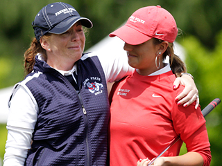 Fresno State women's golf coach Angie Cates (left) and senior Laura Luethke embrace each other after winning the WAC Championship. Cates started the program four years ago and Luethke has been with her all four years. Cates was named Western Athletic Conference Coach of the Year.