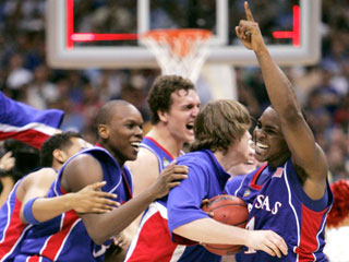 Kansas' Sherron Collins (right) celebrates with teammates after their 75-68 overtime win over Memphis in the championship game in San Antonio.  Collins scored 11 points for the Jayhawks.  This was the Jayhawks' third national championship in school history.  Their last title came in 1988 over Oklahoma.
