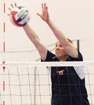 Outside hitter Brett Gillen blocks a ball during a match at the National Campus Championship Series in Dallas. Gillen had 10.5 blocks total.
