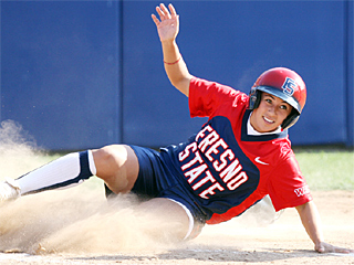 Outfielder Mallory Perkins slides in to score in the second game of a double header Saturday against Hawaii. The Bulldogs won the second game, 2-1, in eight innings.