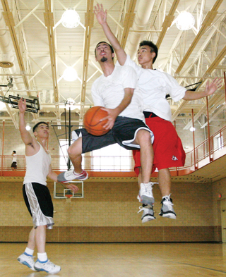 For $25, Fresno State students and staff can take advantage of facilities at the Student Recreation Center. (From left) Students Ravy Heng, Ronnie Mares and Hung Le played basketball at the Rec Center courts on Sunday.