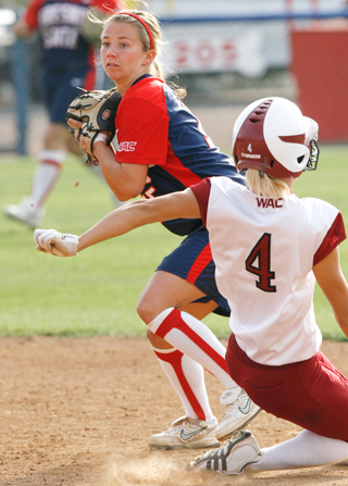 Shortstop Haley Gilleland turns a double play against the New Mexico State Aggies during Saturday's game one victory. The Bulldogs swept the three-game series and secured the No. 2 spot in the WAC Tournament in Honolulu, Hawaii. Fresno State owns a 49-9 overall record and is 14-3 in conference play.