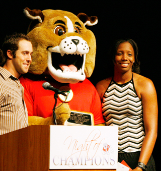 Erica Henry (right) and Steve Susdorf (left) received the George Ilg award at the Night of Champions. This award was given to the two seniors who excelled in the classroom, in the community and in their sport.