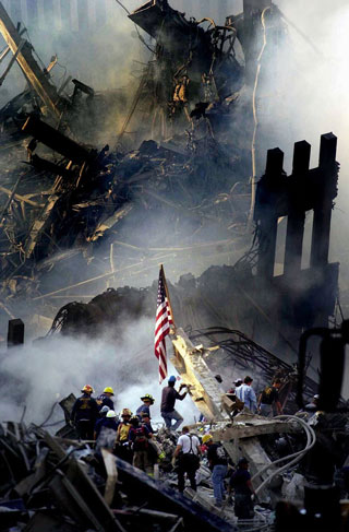 Rescue workers remove a body from the debris of the World Trade Center on Thursday, September 13, 2001, in New York.