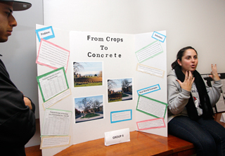 The projected population growth through 2040 will cut out the majority of the farmland in the Central Valley.  Angel Tello, left, and Bethany Davis presented the idea of compact growth, building houses up, not out, to prevent the loss of farmland.