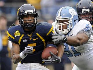Former West Virginia quarterback Pat White was initially projected to be a wide receiver in the NFL, but could be a quarterback in the Wildcat.