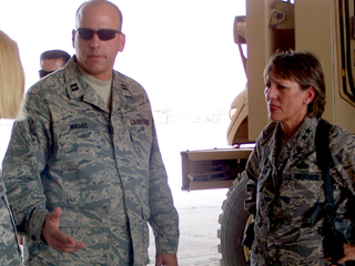 Captain Magoc explaining operations to visiting Air Force Personnel Center Commander MG McClain, in Iraq.