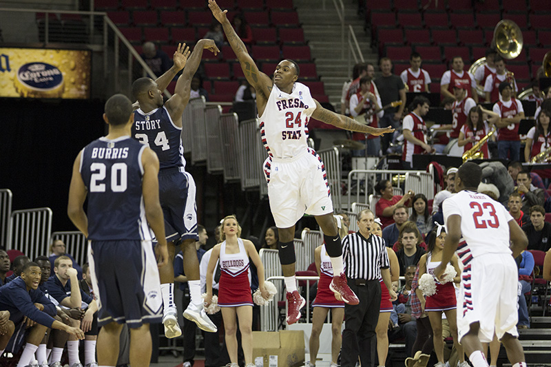 Fresno State's forward, Kevin Foster, makes an attempt to block the Wolfpack's guard, Malik Story, shot on Saturday nights home game. Photo by Roe Borunda / The Collegian
