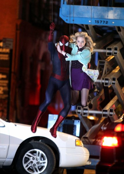 "Andrew Garfield and Emma Stone film an action scene on location for the film ""The Amazing Spider-Man 2"" on June 4, 2013 in New York City."