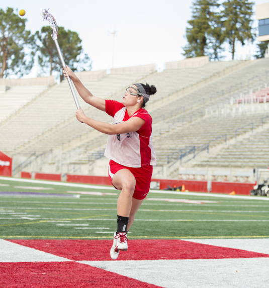 Fresno State lacrosse standout Kara Concheck receives a pass during a Bulldogs practice. Photo by Katie Eleneke/The Collegian