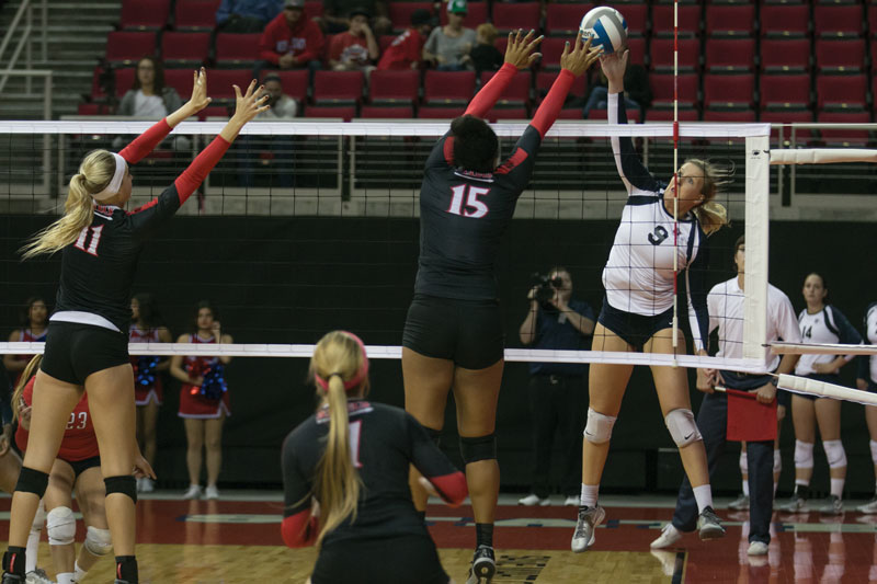 Fresno State senior outside hitter Jamiee-Lee Morrow (9) attempts a kill during Fresno State's 3-1 loss to the San Diego State Aztecs Thursday at the Save Mart Center. Photo by Logan Downing/The Collegian