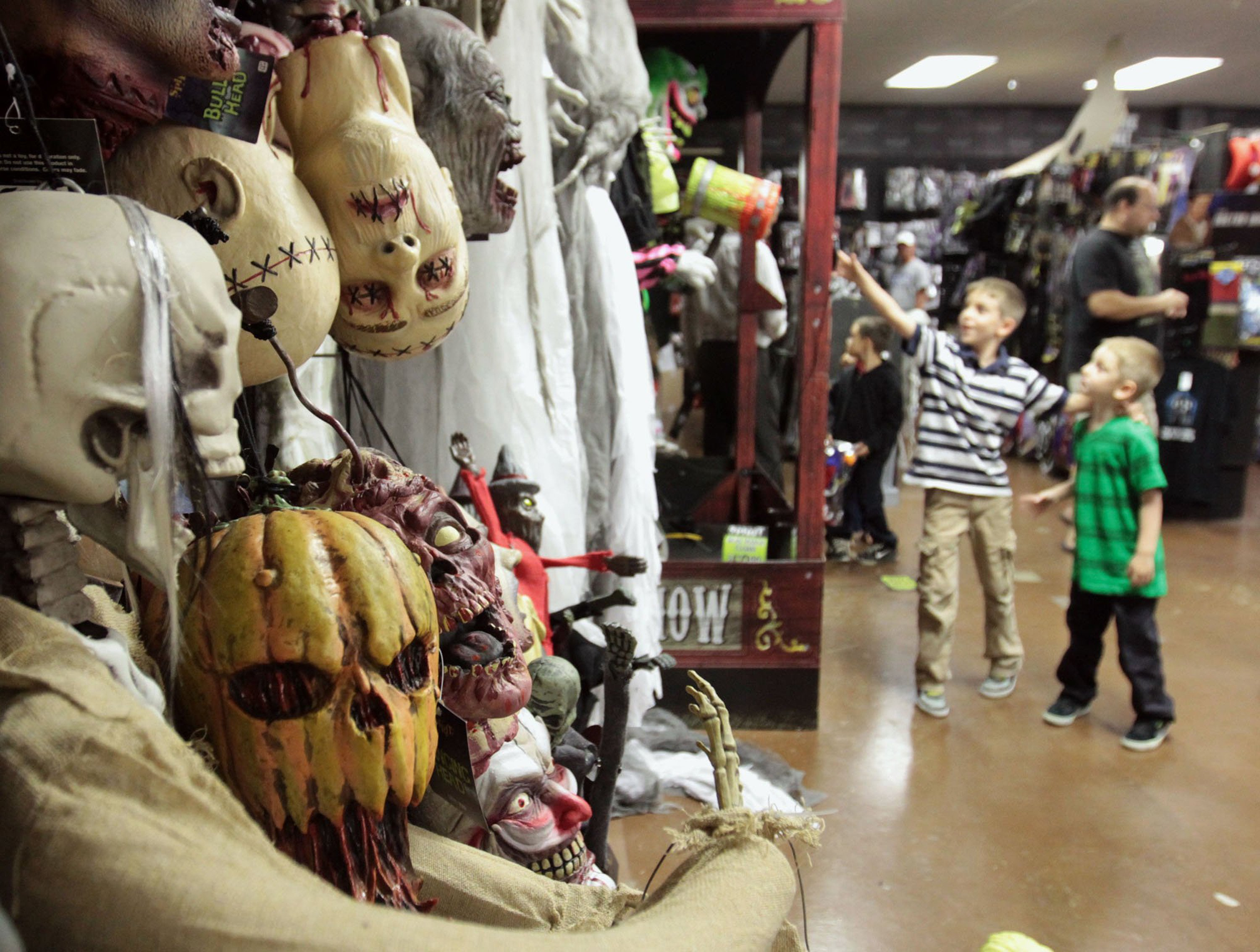 connor bartholomew 8 and his brother miles 5 right enjoy - Halloween Store Spirit