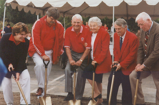 A group of people, including Earl and Muriel Smittcamp, break gound on the Smittcamp Alumni House in 1998. Photo courtesy of University Communications