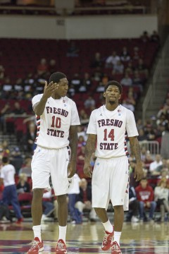 Fresno State sophomore Alex Davis (left) chats with transfer Julien Lewis (right) during the 'Dogs' loss to the California Golden Bears Sunday at the Save Mart Center. Photo by Paul Schlesinger/The Collegian