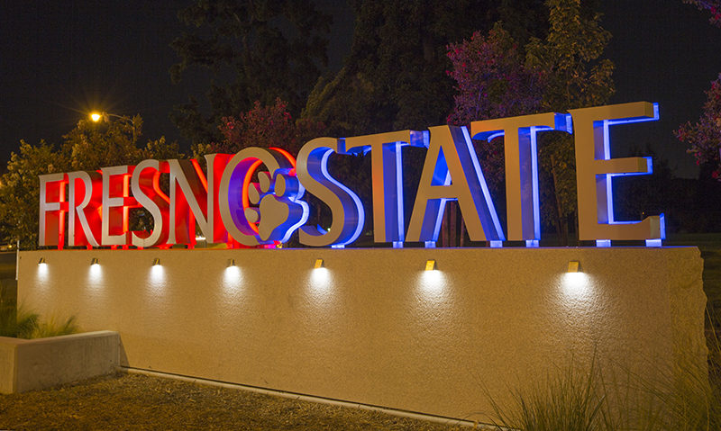 Fresno State logo with lights at night