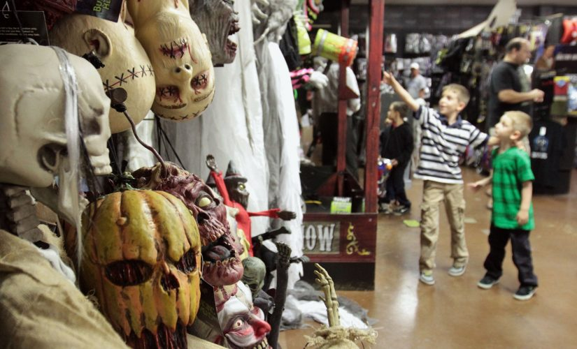 connor bartholomew 8 and his brother miles 5 right enjoy holiday themed displays at spirit halloween in biloxi mississippi on wednesday october 23
