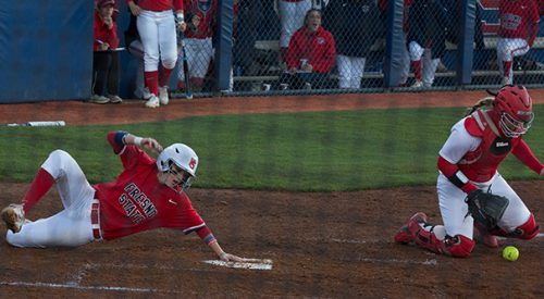 Softball: 'Dogs take Game 1 in shortened workday article thumbnail mt-3