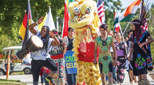 Students walk proudly in the Cross-Cultural Celebration Parade article thumbnail mt-3