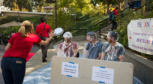 A pie in the face means money for Student Cupboard article thumbnail mt-3