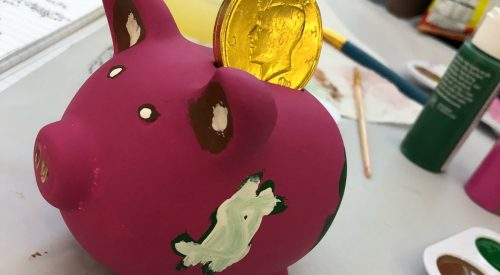 Students learn about finances by painting piggy banks article thumbnail mt-3
