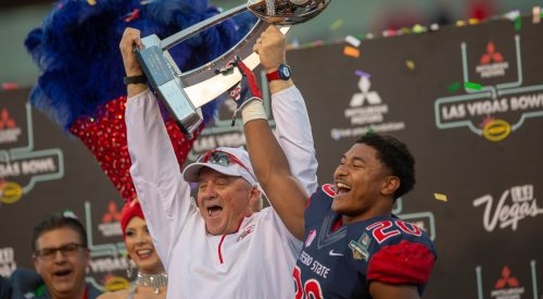 'Dogs emerge from the desert victorious once again, capturing Vegas Bowl title article thumbnail mt-3