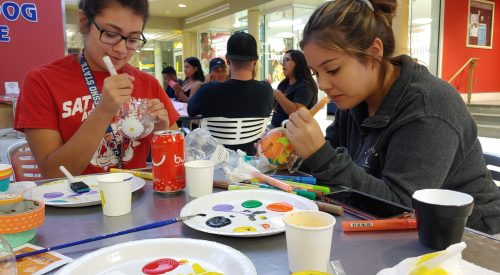 Students decorate gum ball machines at Crafts Night article thumbnail