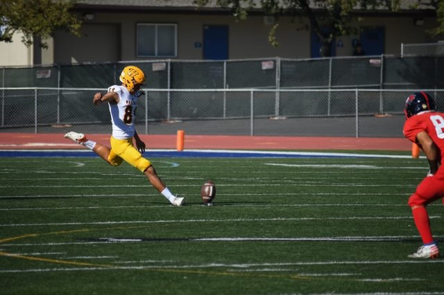 Abraham Montaño takes the opening kickoff for Hartnell College.
