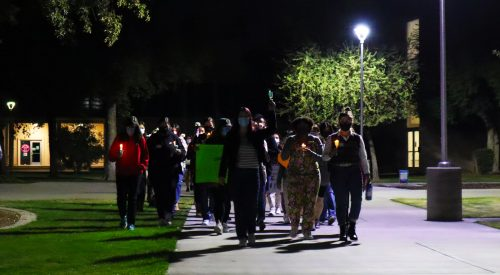 Campus lights up in protest of violence and sexual assault article thumbnail